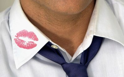Man with lipstick kiss mark on his shirt's coollar