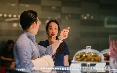 Couple at the restaurant with the girl looking unsure